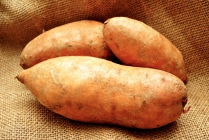 Three Sweet Potatoes on Burlap